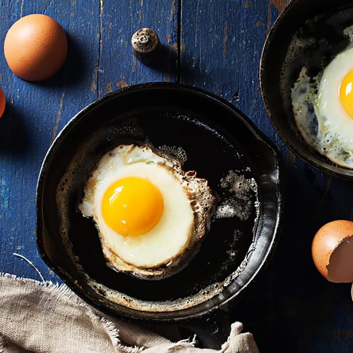 eggs cooking in skillet