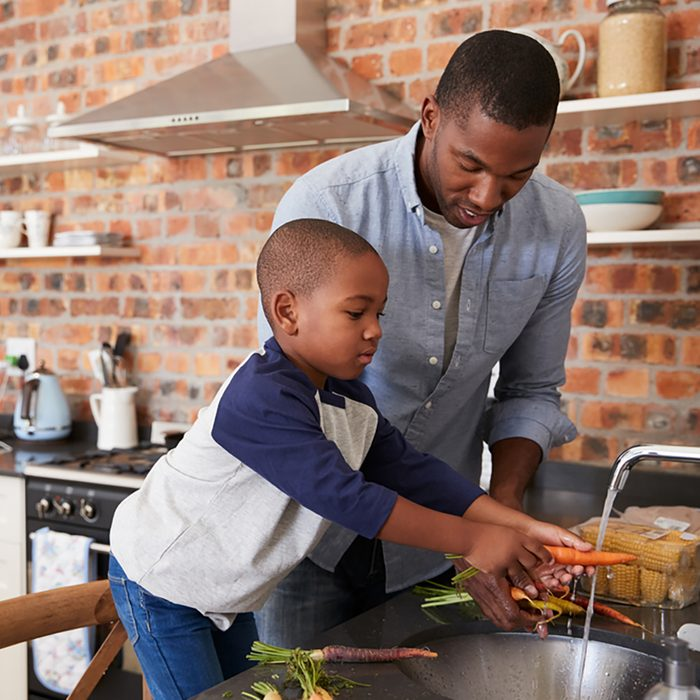 Son Helping Father To Prepare Vegetables For Meal In Kitchen; Shutterstock ID 627670430; Job (TFH, TOH, RD, BNB, CWM, CM): TOH Amazon Echo