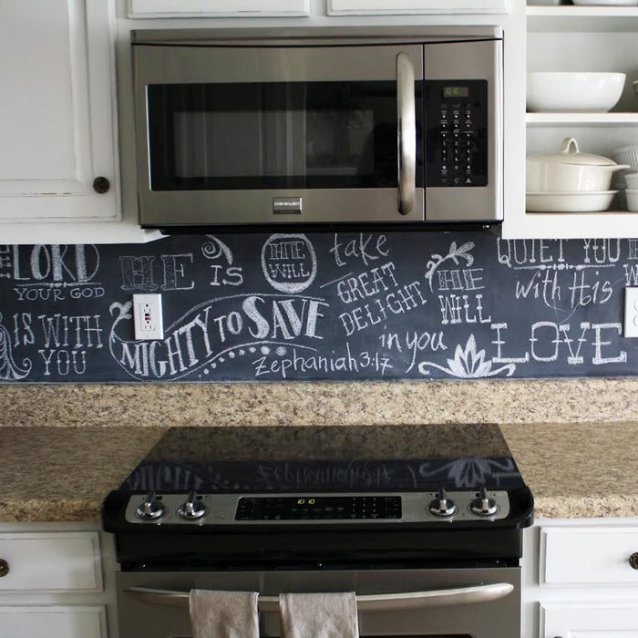 Kitchen featuring a chic chalkboard backsplash