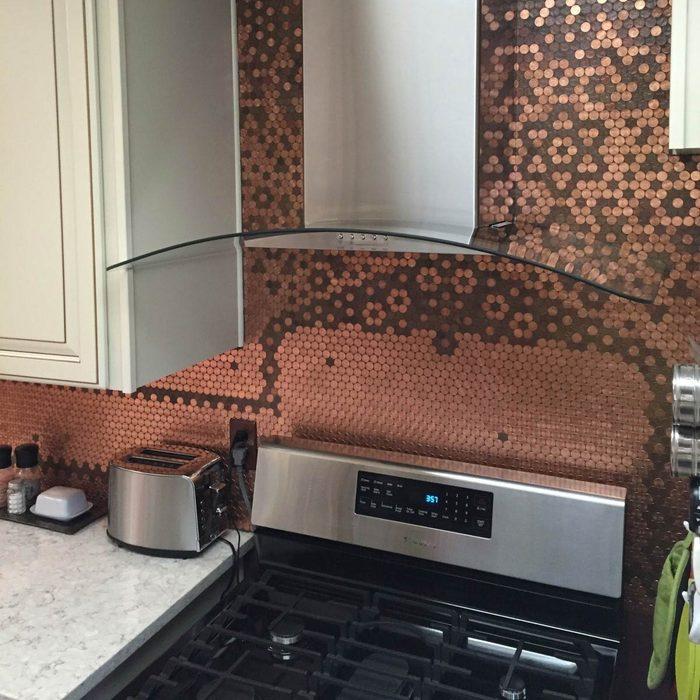 Kitchen with pennies decorating its backsplash