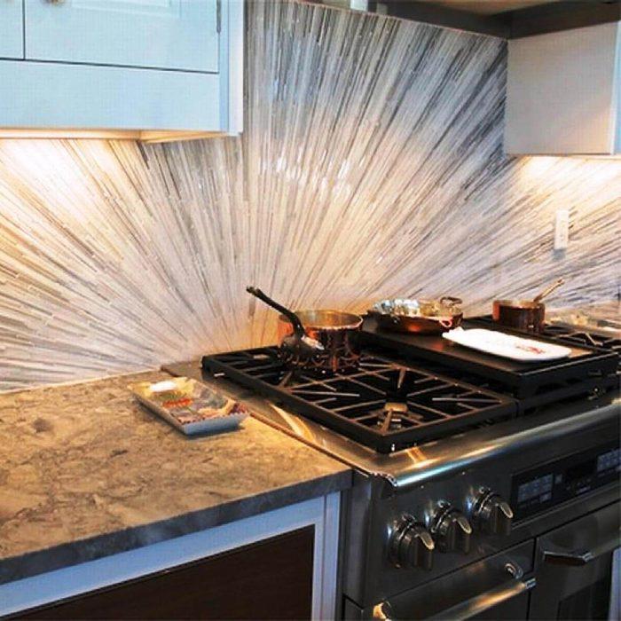 Kitchen with sunburst backsplash