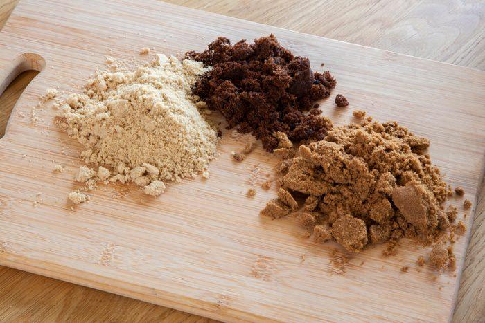 Different types of sugar - dark brown soft, light brown soft & molasses - natural unrefined cane sugar.