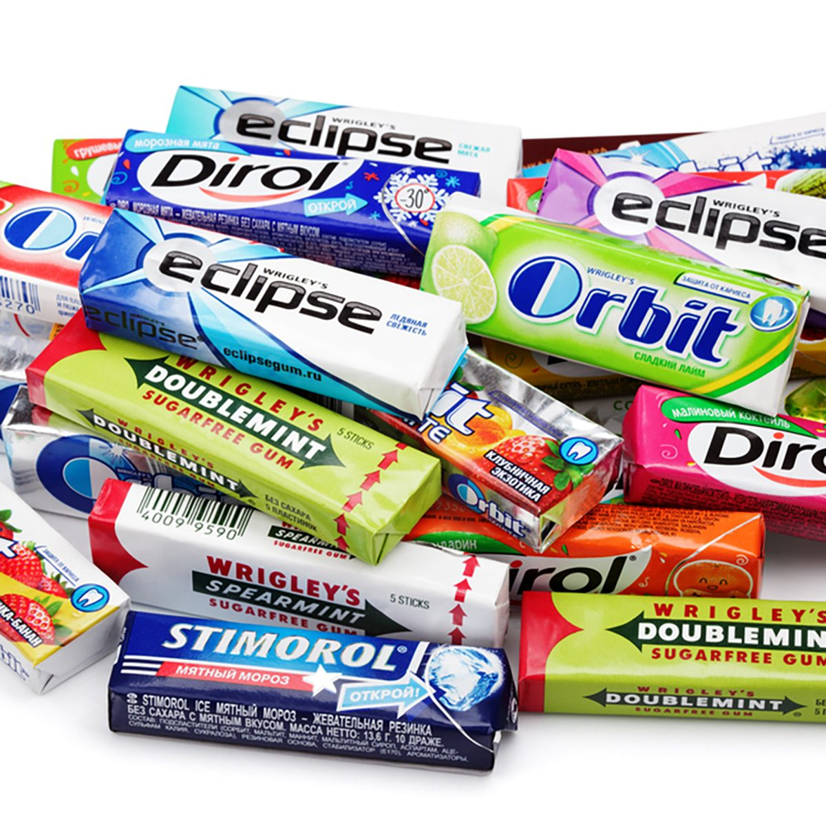 Heap of various brand chewing or bubble gum including Orbit, Dirol, Eclipse, Stimorol, Wrigley Spearmint and Doublemint