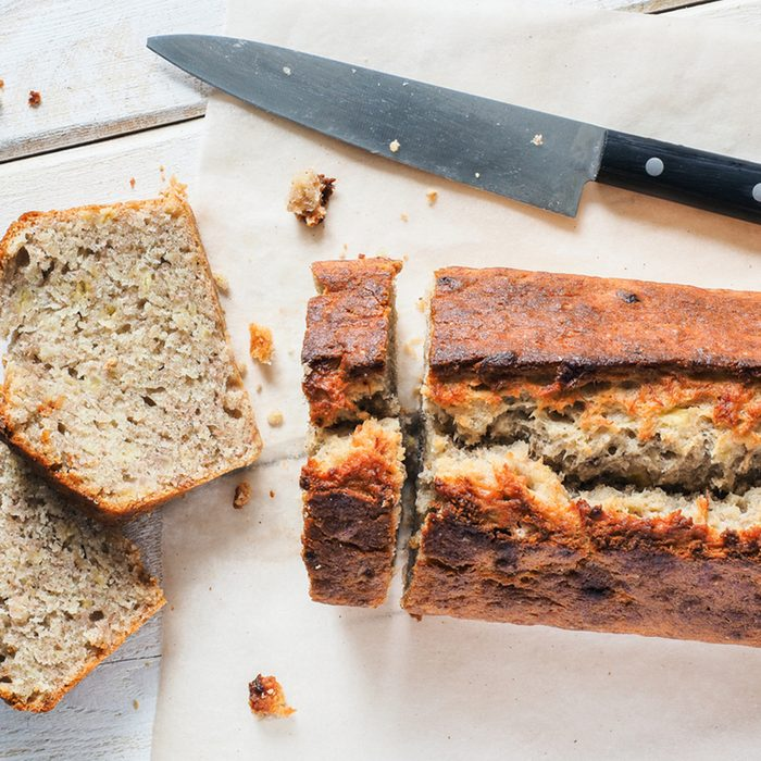 Cake Banana bread cut at the white table with knife