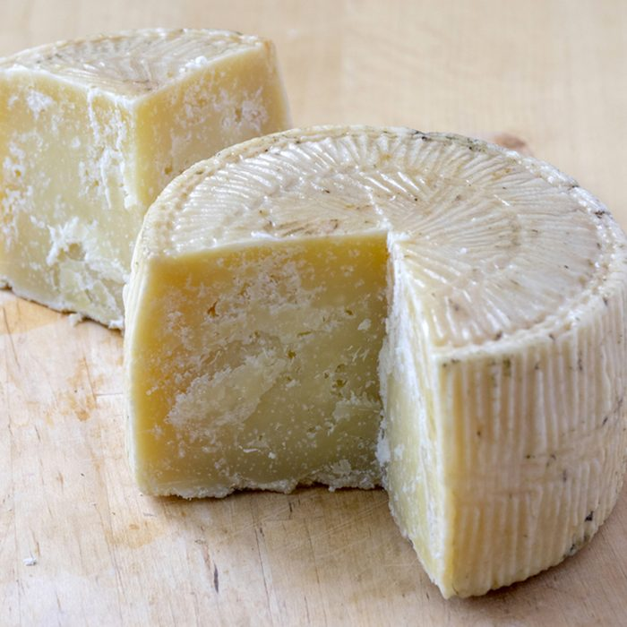 Pecorino cheese on wooden table