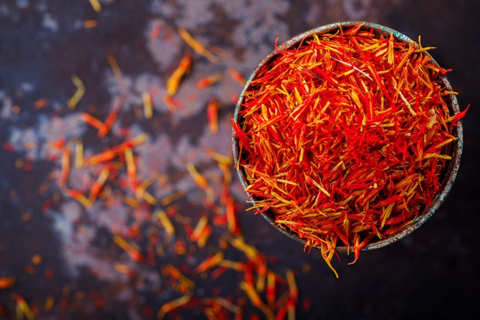 Dried saffron spice in a metal glass