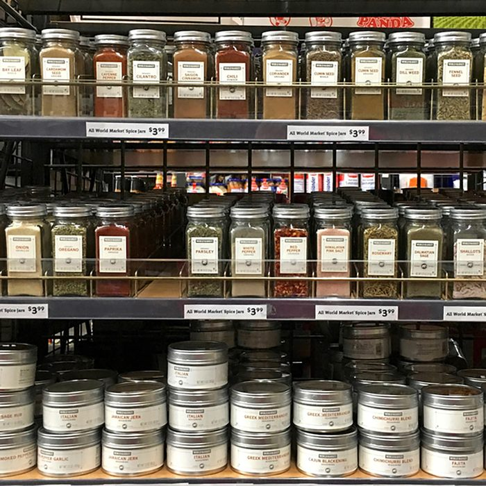 Grocery store shelf with jars of herbs and spices. Fresh herbs and spices can take a dish from good to great.