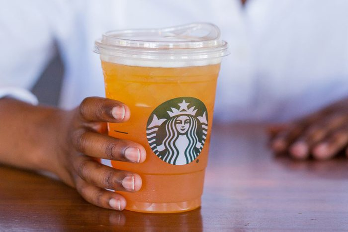 Person holding the new Starbuck's cup with lid