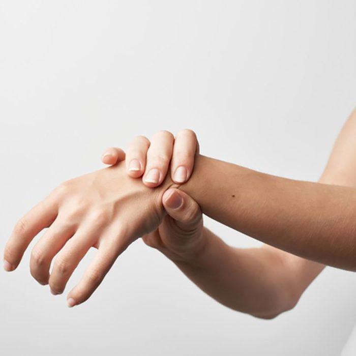 woman holding up wrist