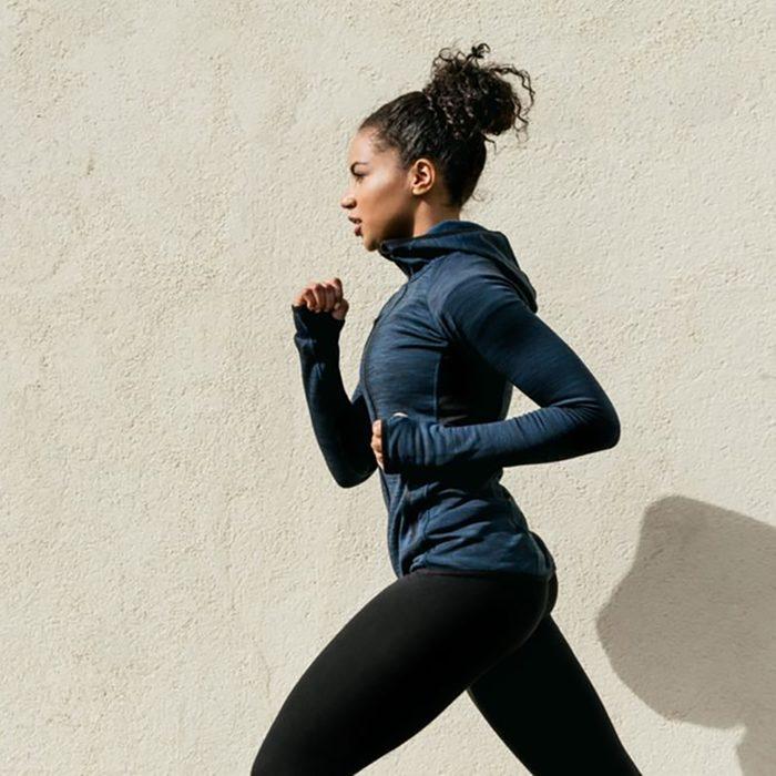 woman jogging in long sleeve shirt and leggings