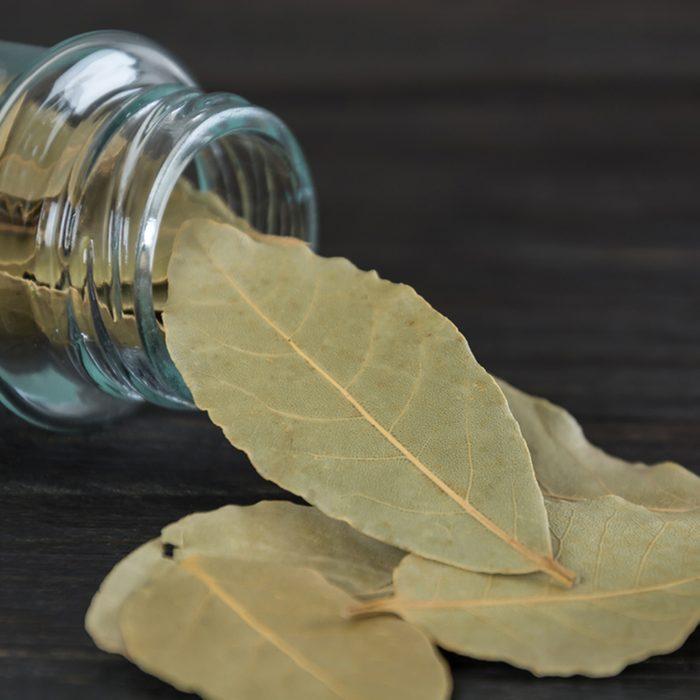 bay leaves in bottle on wood