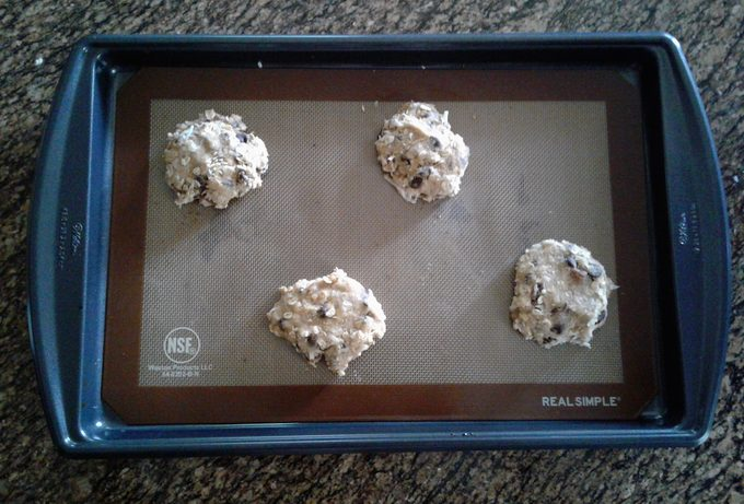 Cowboy Cookies dough on a cookie sheet