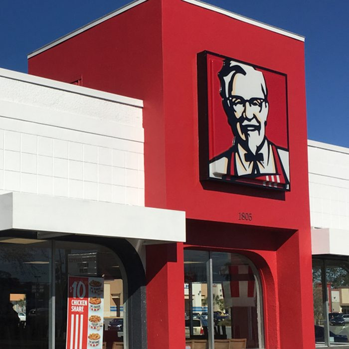 KFC Kentucky Fried Chicken retail restaurant store front with Colonel Harland David Sanders logo portrait sign Saint Augustine, Florida USA