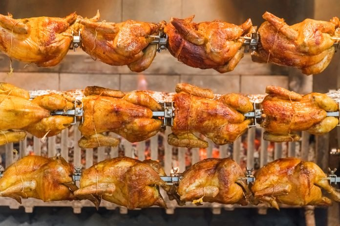 Grilled chickens on a spit