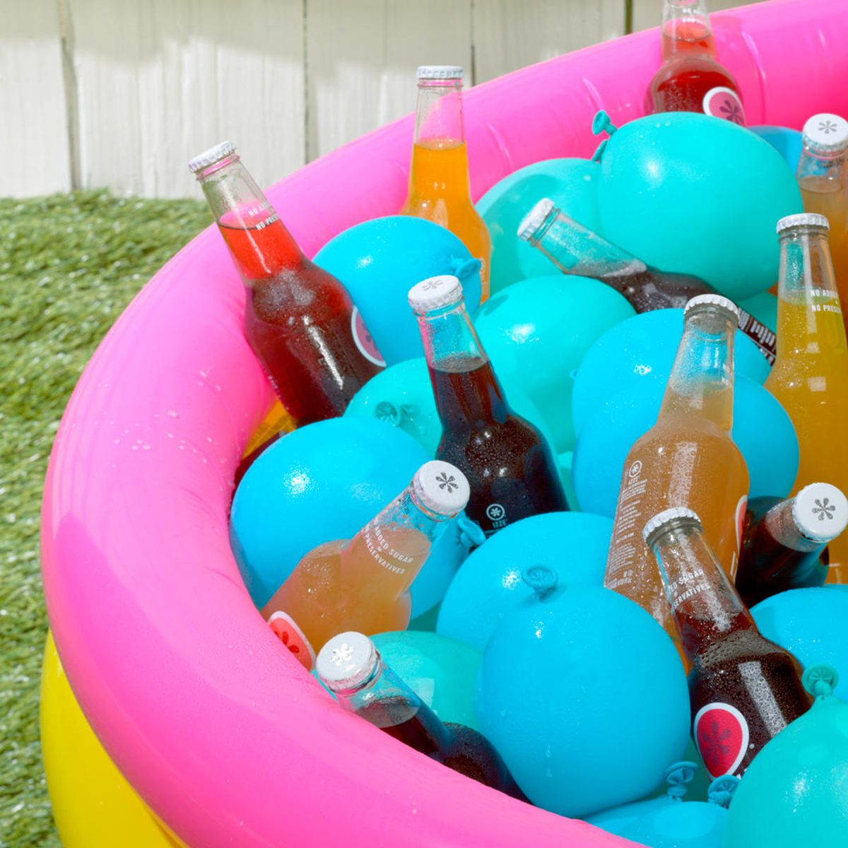 Kiddie pool filled with frozen water balloons and drinks