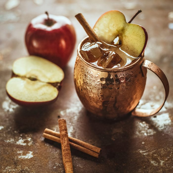 Icy Cold Moscow Mule cocktail with Ginger Beer, Vodka, apple and cinnamon