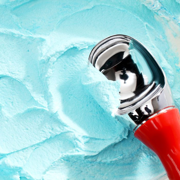 High Angle Close Up View of Red Handled Scoop Serving Blue Colored Ice Cream; Shutterstock ID 286485767; Job (TFH, TOH, RD, BNB, CWM, CM): Taste of Home
