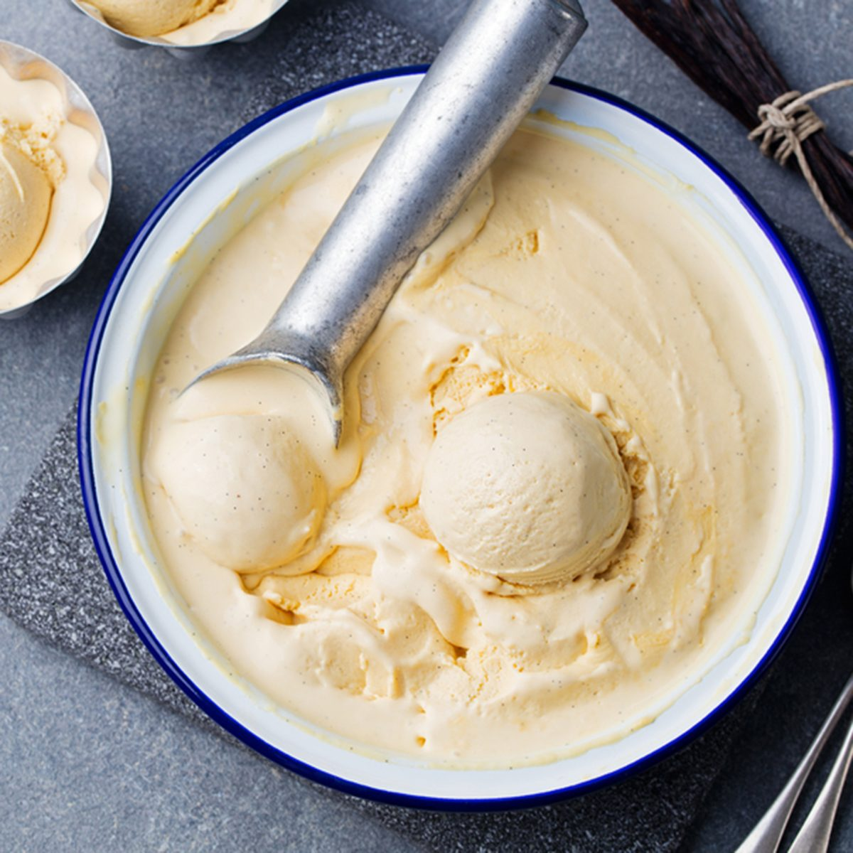 Homemade vanilla, caramel ice cream in vintage bowl Organic product on a grey stone background; Shutterstock ID 413974858; Job (TFH, TOH, RD, BNB, CWM, CM): Taste of Home