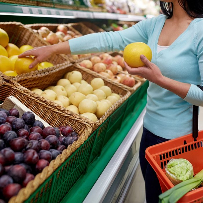 sale, shopping, food, consumerism and people concept - woman with basket buying pomelo at grocery store; Shutterstock ID 558274159; Job (TFH, TOH, RD, BNB, CWM, CM): Taste of Home