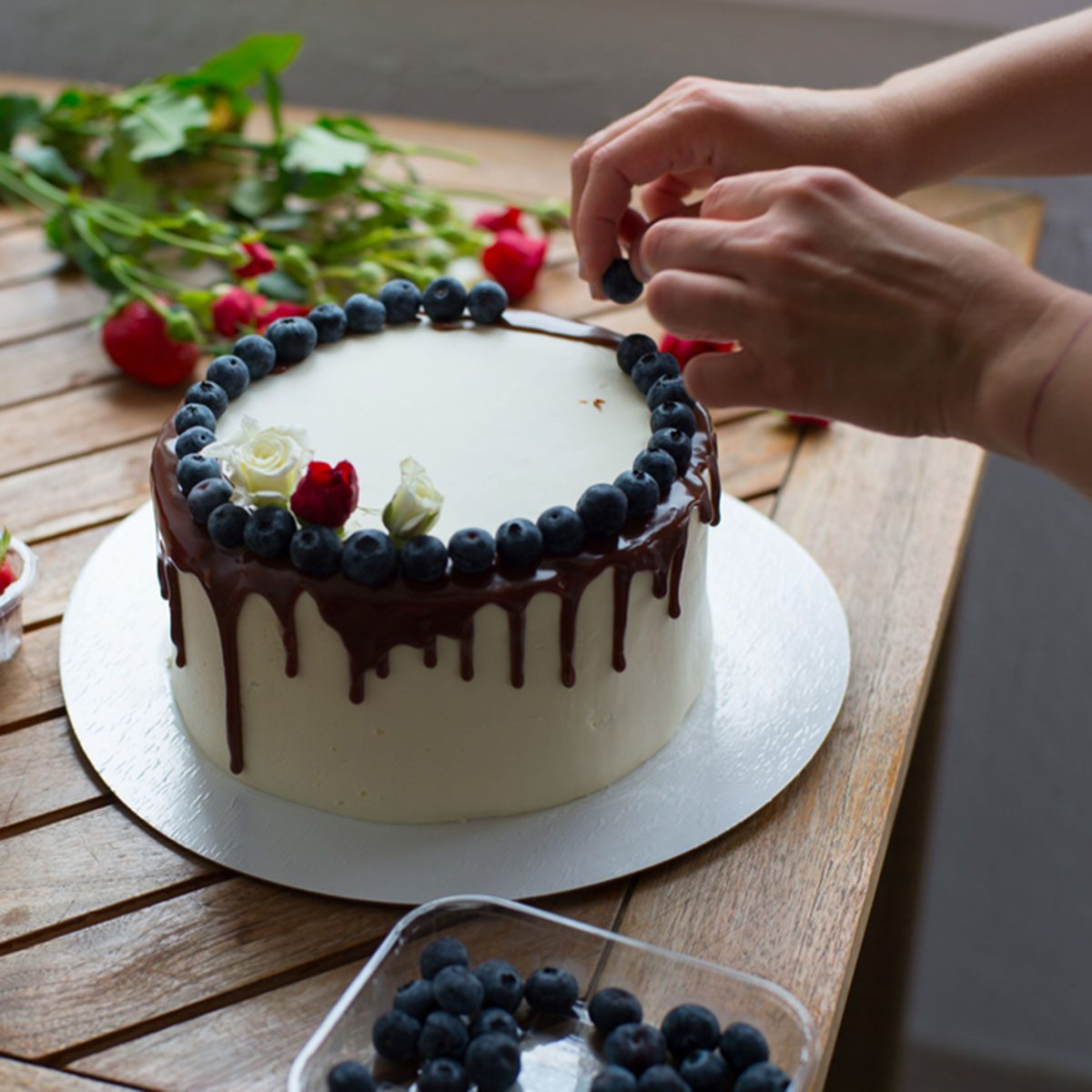 Baker adding blueberries to a cake; Shutterstock ID 645905908; Job (TFH, TOH, RD, BNB, CWM, CM): Taste of Home