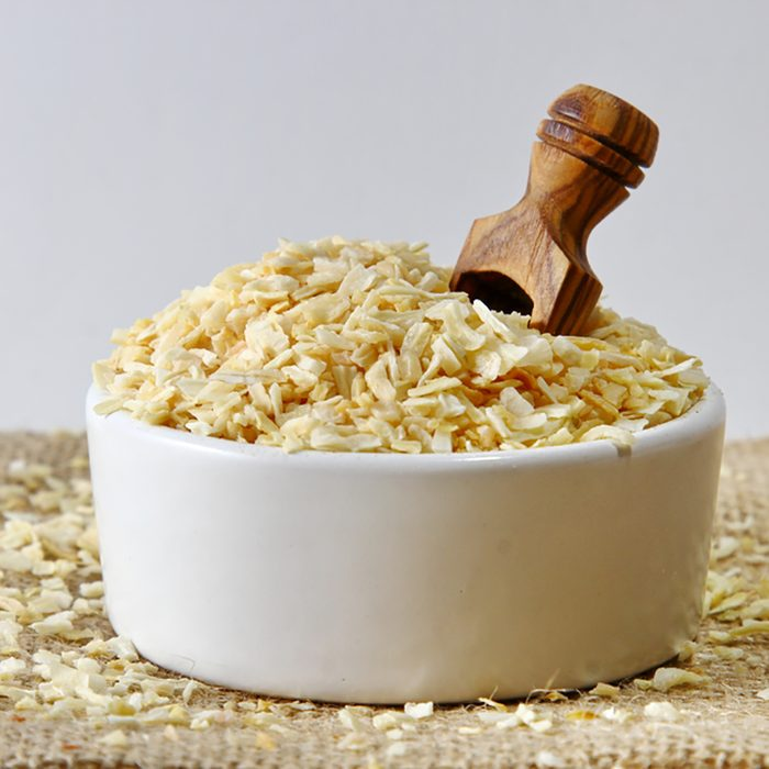 Dehydrated Onion flakes in a ceramic bowl;