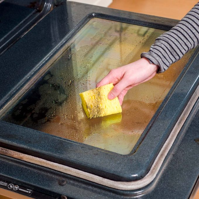 Using a sponge-cleaning an oven window