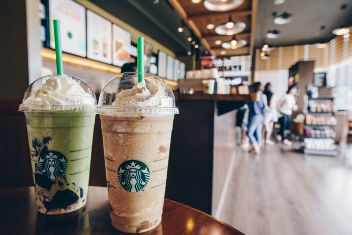 Two Starbucks blended drinks on a table