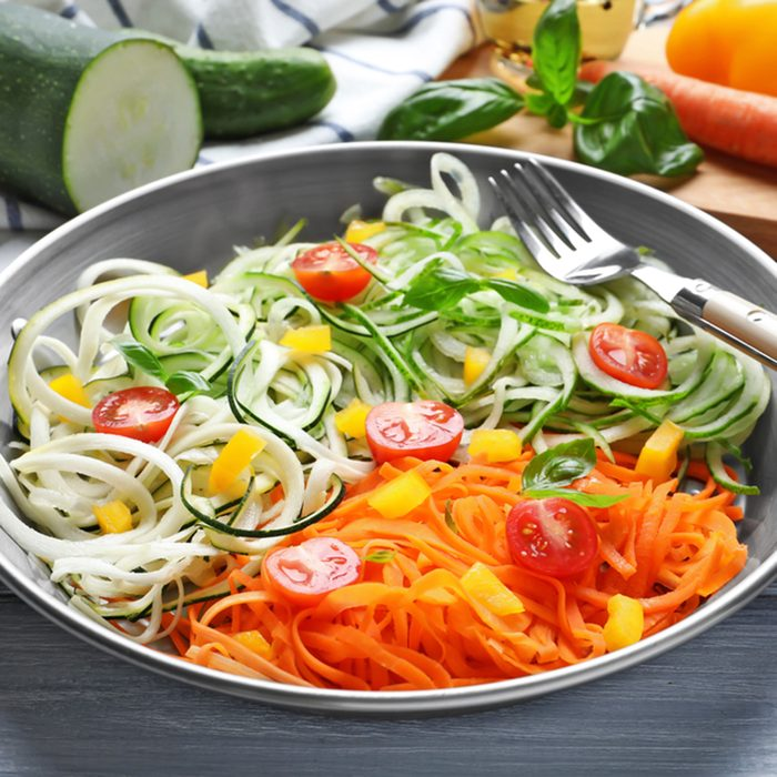 Frying pan with delicious vegetable spaghetti on table