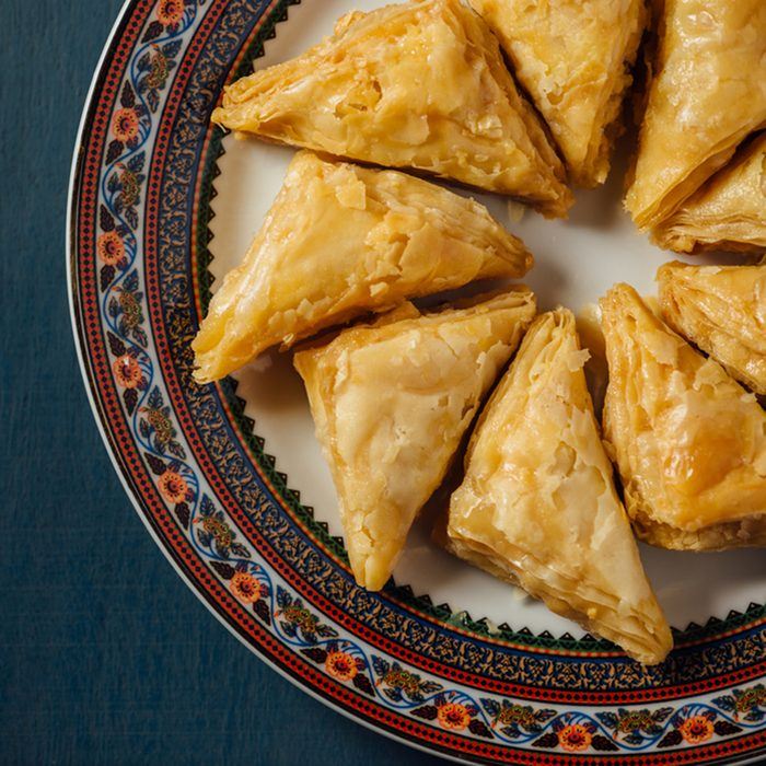Baklava - an arabian sweet made with baked filo, stuffed with crushed nuts and basted with honey or sugar syrup.