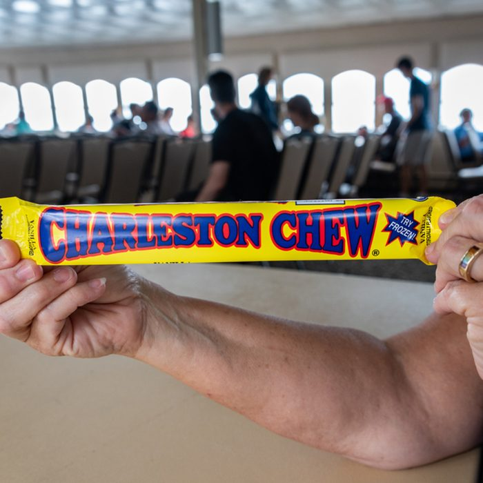 Charleston Chew candy bar being held by a woman on a Fort Sumter-bound ferry boat.