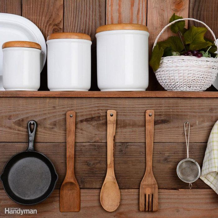 Organized pots and utensils on a wall