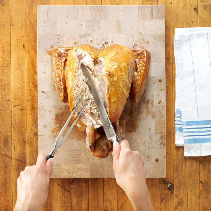 Carving a turkey removing a breast