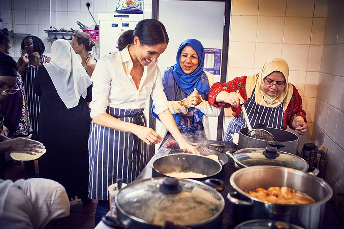 Meghan Duchess of Sussex cooking with women in the Hubb Community Kitchen at the Al Manaar Muslim Cultural Heritage Centre in West London