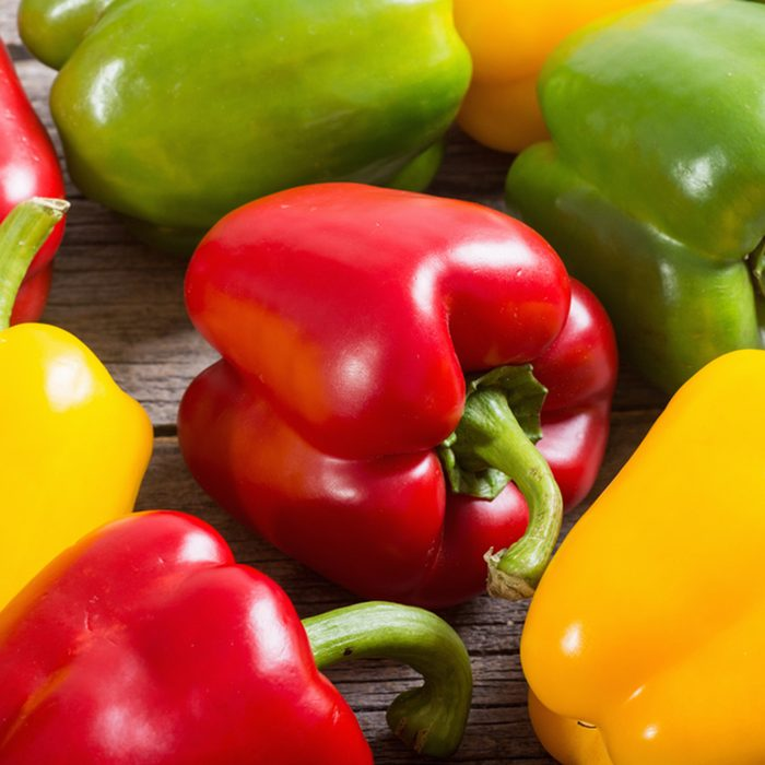 Colorful green , red and yellow peppers paprika background