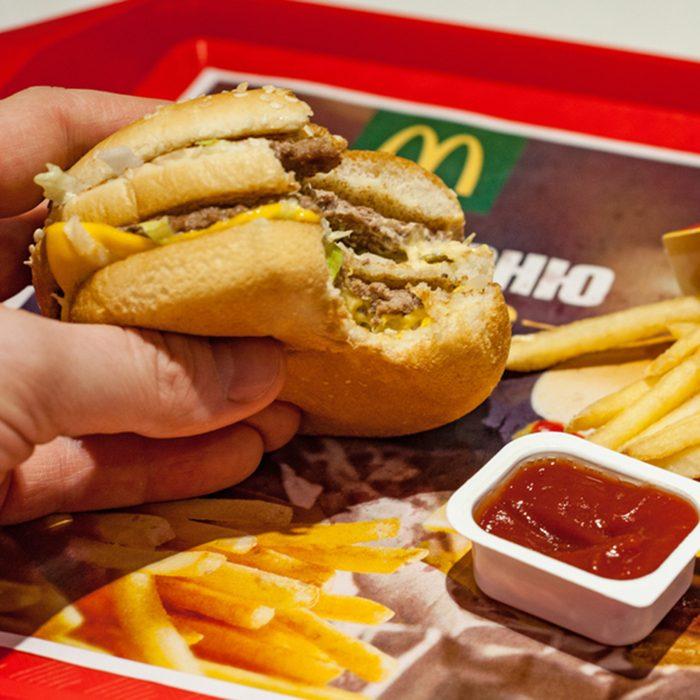Man is eating at McDonald's restaurant.