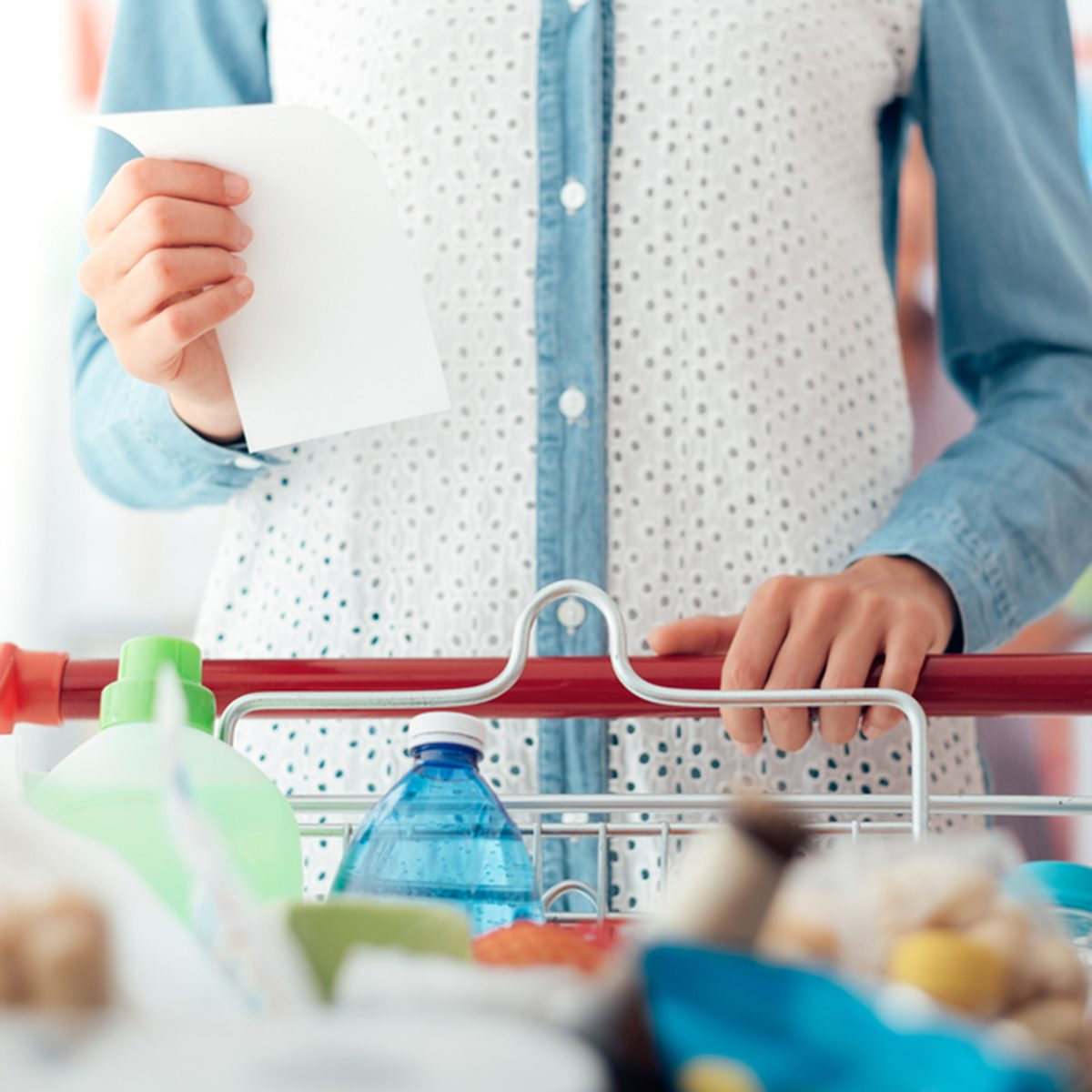 Woman doing grocery shopping at the supermarket