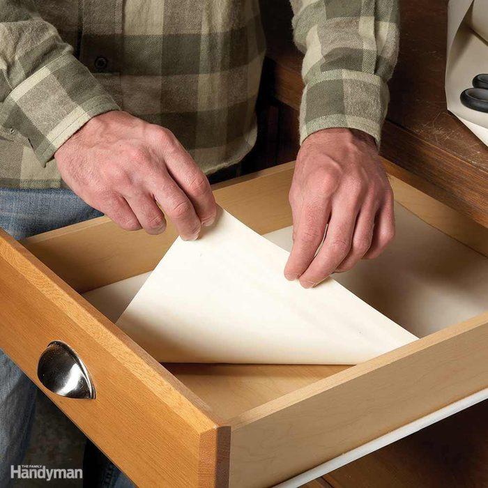 Inserting shelf liner