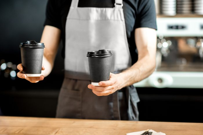 Barista holding paper cups to take away with coffee on the counter of the coffee shop; Shutterstock ID 1087957532; Job (TFH, TOH, RD, BNB, CWM, CM): TOH National Free Coffee Day
