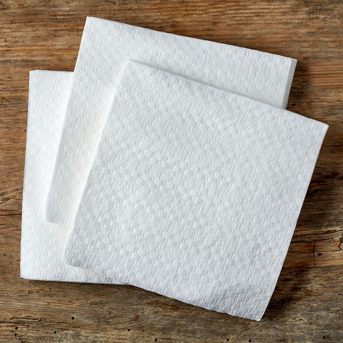 White paper napkin on wooden table, top view; Shutterstock ID 374417176; Job (TFH, TOH, RD, BNB, CWM, CM): Taste of Home