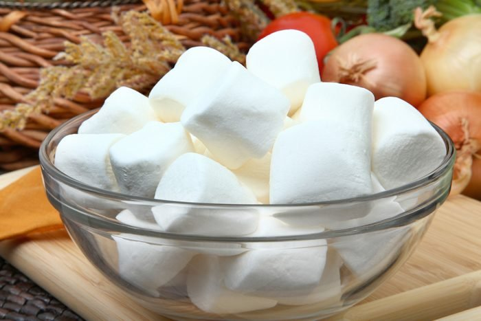Glass bowl of white marshmallows in kitchen.; Shutterstock ID 41643064;
