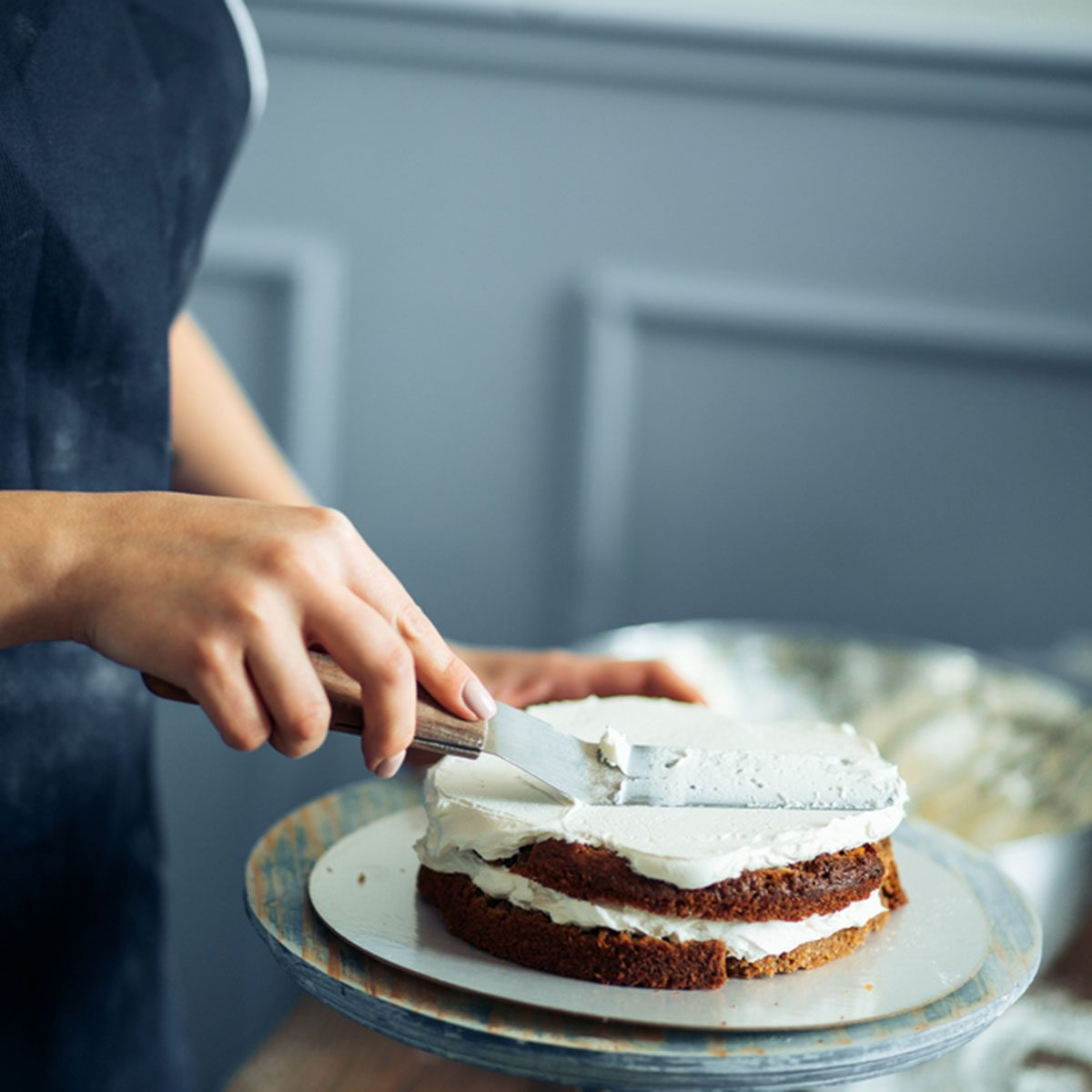Woman Carefully Icing The Cake And Decorating; Shutterstock ID 649601008