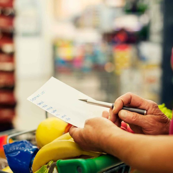 Woman looking over her shopping list