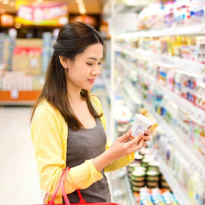 Woman reading product in grocery store