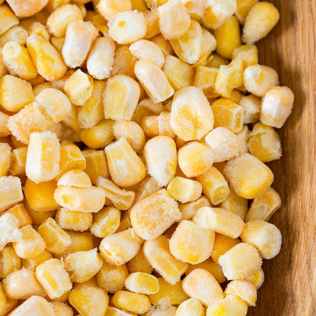 frozen sweet corn on woode surface