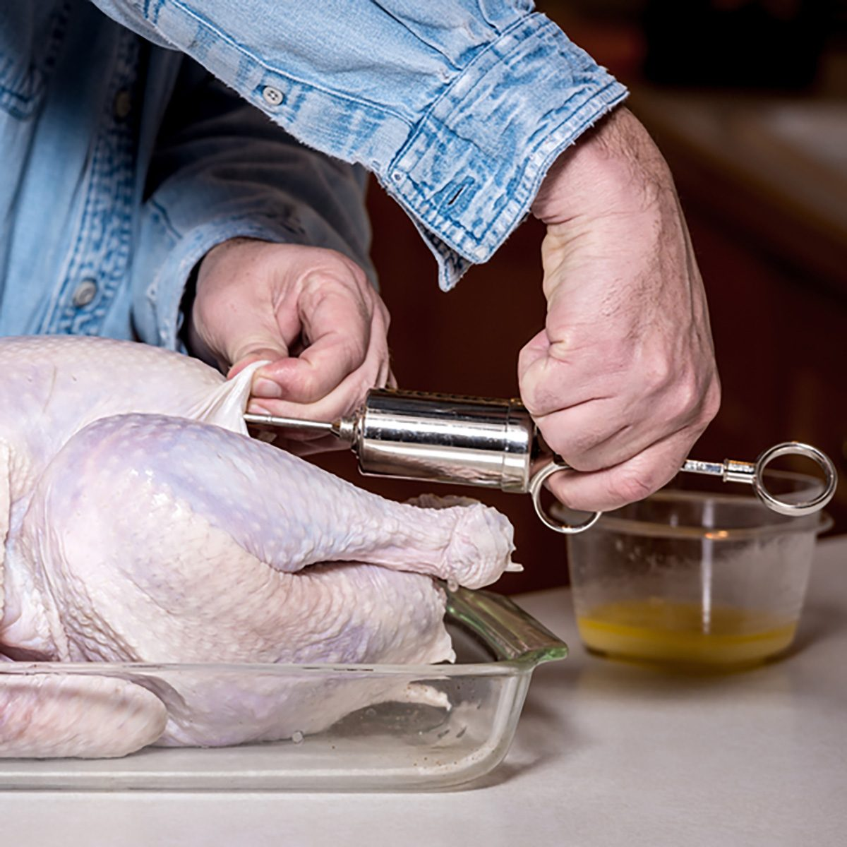 Demonstration of injecting a turkey