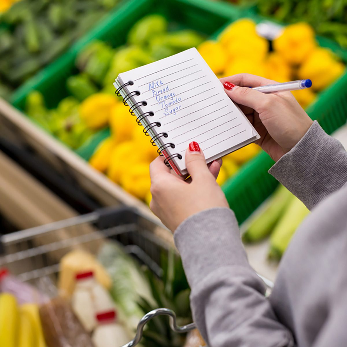 Woman with notebook in grocery store, closeup