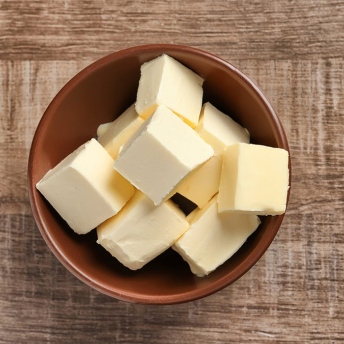 Bowl with cubes of butter on wooden background; Shutterstock ID 751443889; Job (TFH, TOH, RD, BNB, CWM, CM): Taste of Home