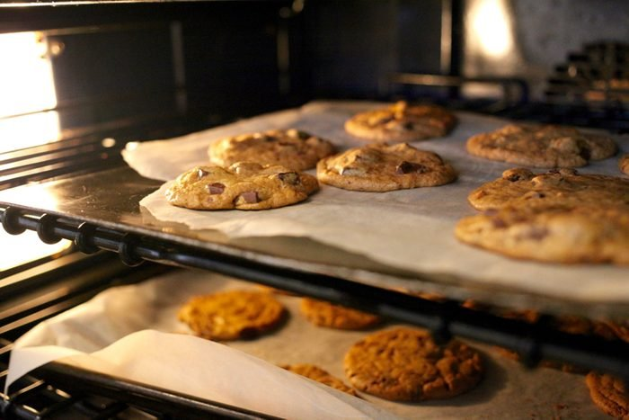 Fresh chocolate chip cookies being baked in an oven; Shutterstock ID 779345518; Job (TFH, TOH, RD, BNB, CWM, CM): Taste of Home