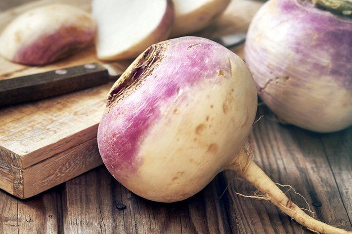 Closeup of raw organic turnips on rustic wooden background