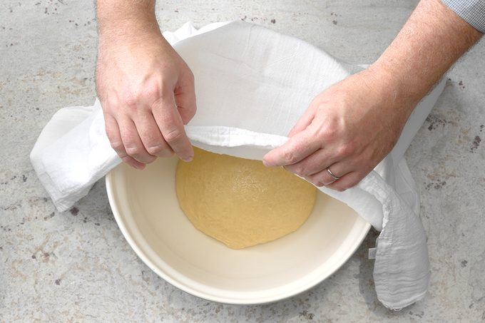 Show Bowl With Dough Ball In Bowl, Towel Half Covering It